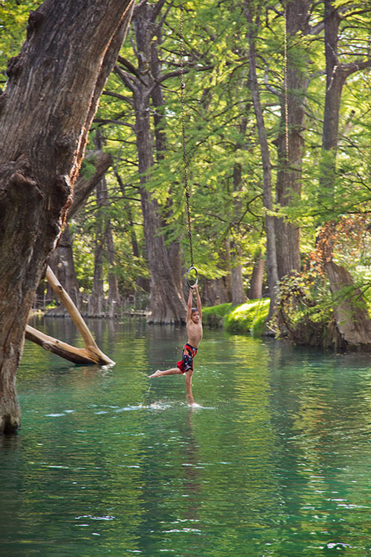 1008Boy on swing, Blue Hole, Wimberly, Texas