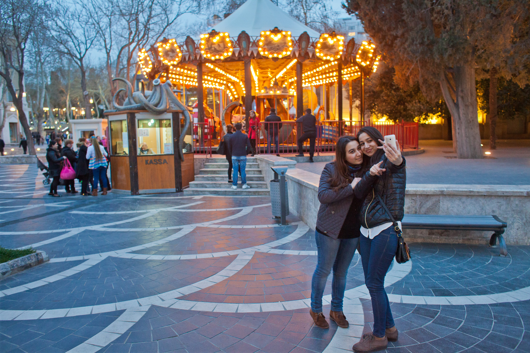 1015Muslim Girls taking selfie with carousel Baku, Azerbaijan, Nizami street %22Torgovaya%22