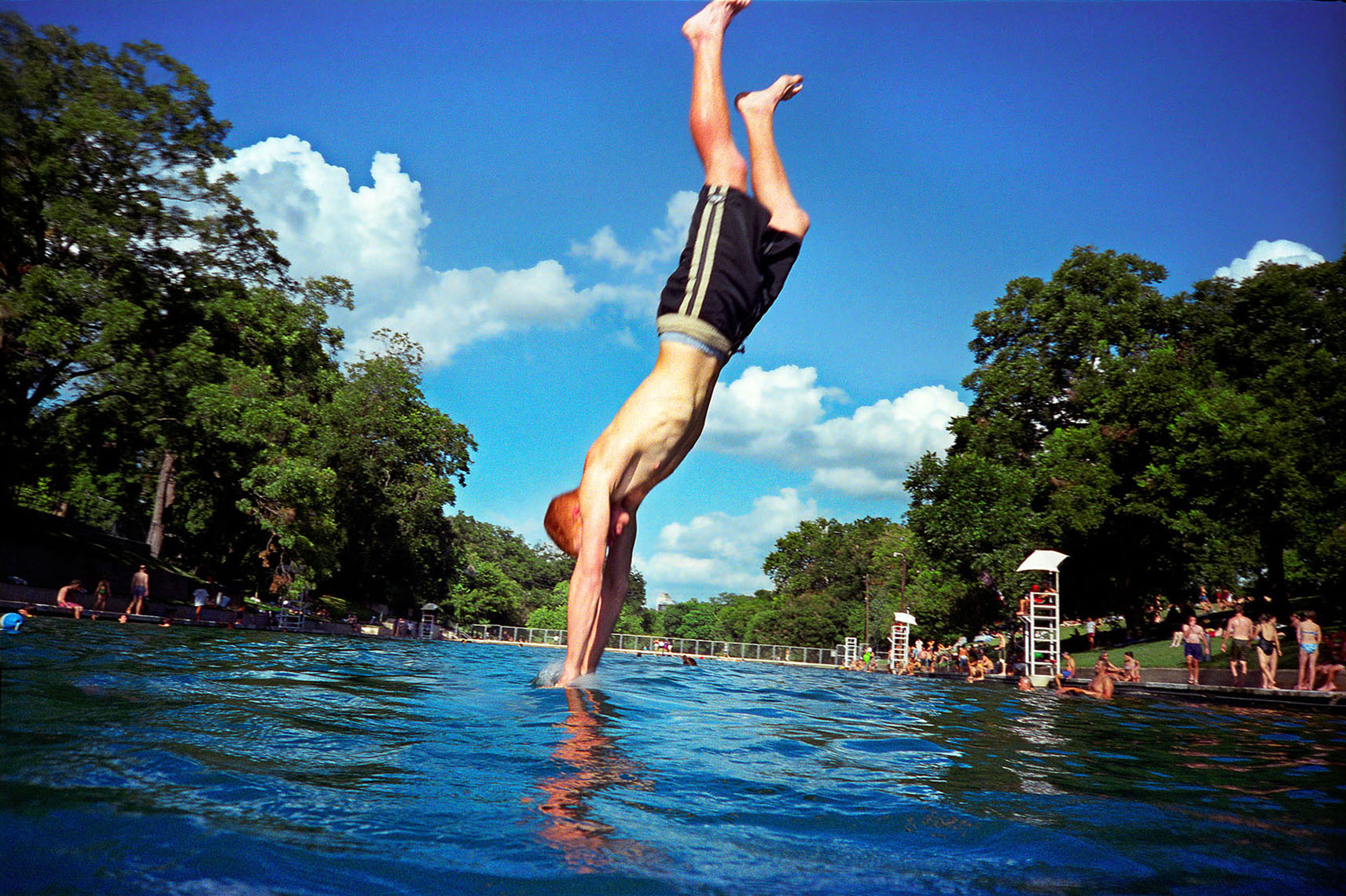 1146Barton Springs, Spring fed pool, boy diving, breaking water surface