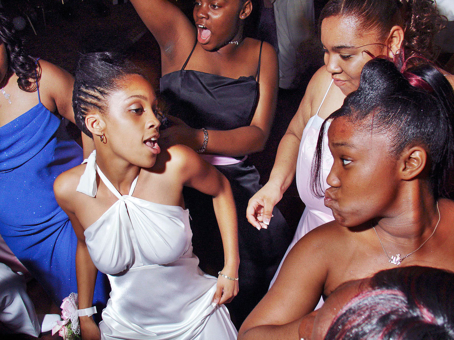 1169African American girls dancing at the High School prom, white halter dress